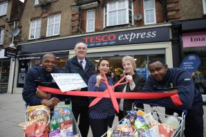 New Tesco opens and hands charity £500